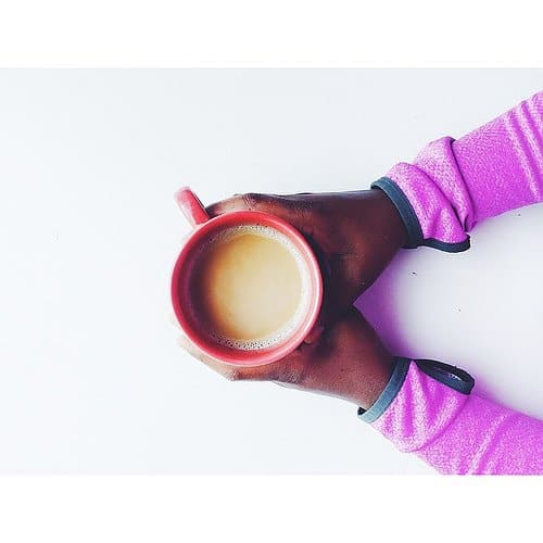 A cup of coffee in hand