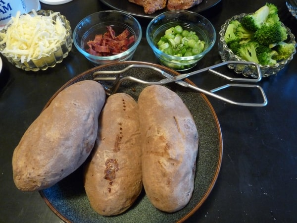 Freshly baked potatoes and toppings