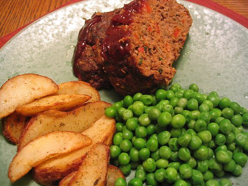 Meatloaf, fries, and green peas