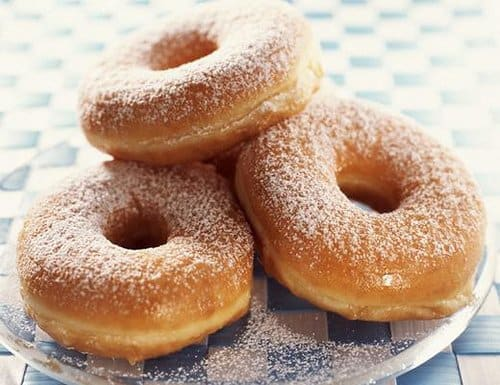 Donuts dusted with powdered sugar