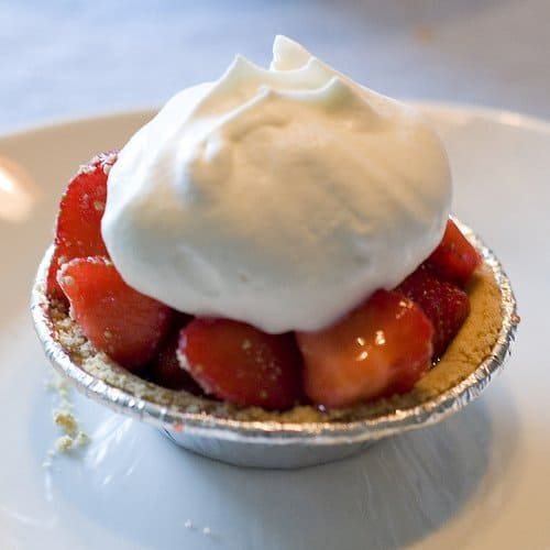 Fruit topped with whipped cream