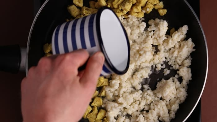 Adding water when reheating risotto