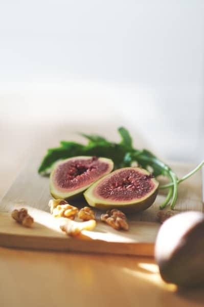 Fig halved on a cutting board
