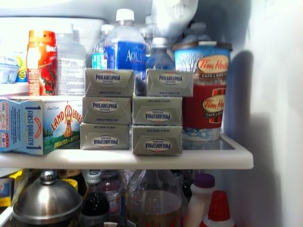 Fridge stacked with Philadelphia cheese