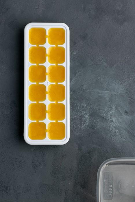 Frozen orange juice in an ice cube tray