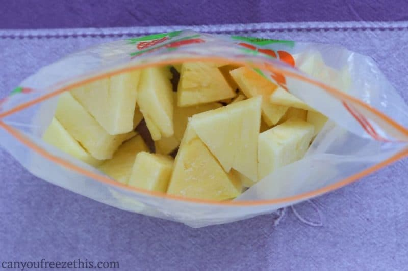 Frozen pineapple in a freezer bag