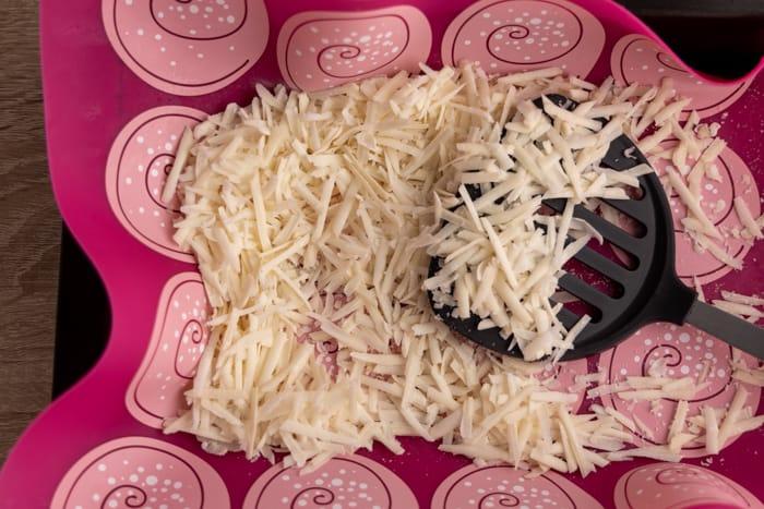 Frozen shredded parmesan stirred
