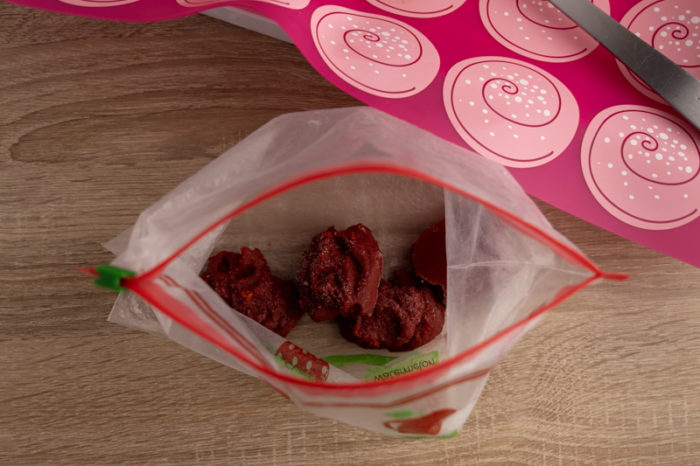 Frozen tomato paste blobs in a freezer bag