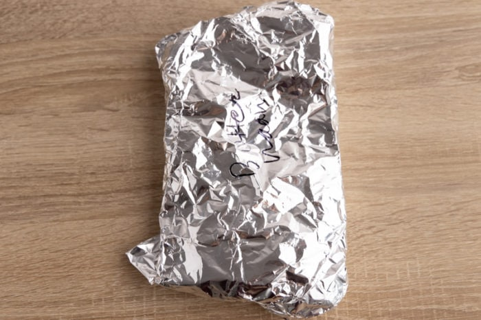 Takeout naan bread wrapped in aluminum foil