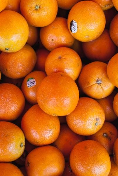 Orange fruits on display
