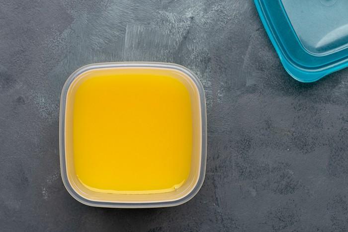Orange juice in a plastic container