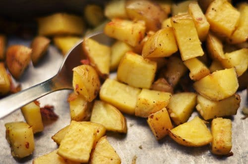 Roasted potatoes and kitchen utensils