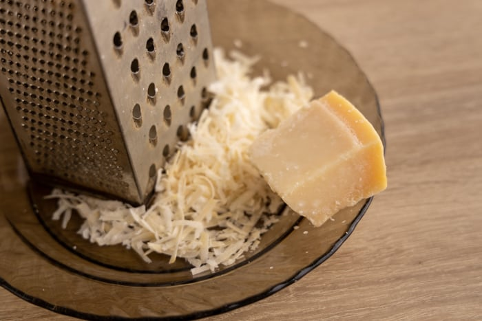 Shredding a frozen parmesan block