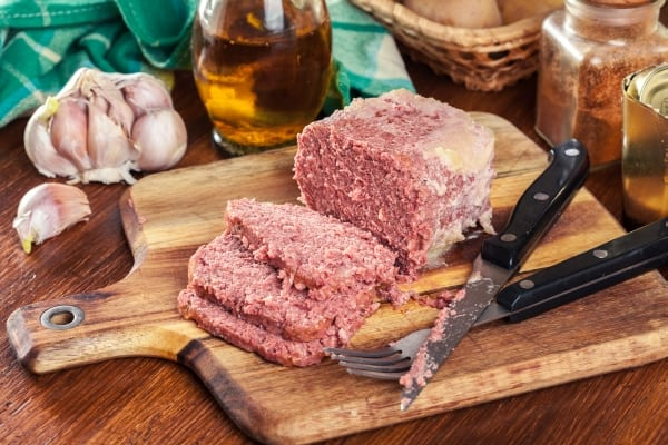 Delicious sliced corned beef on cutting board