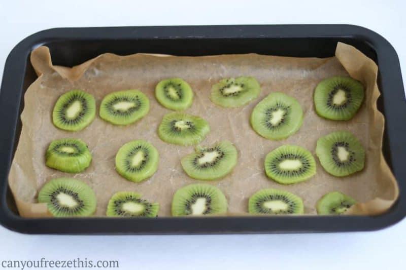 Sliced kiwi on a cookie sheet