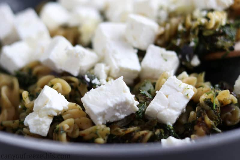 Thawed feta on pasta with spinach