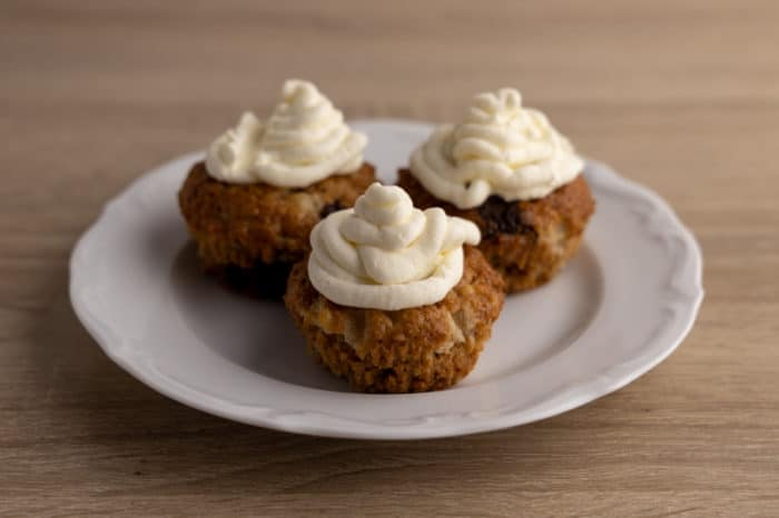 Thawed piped whipped cream on muffins