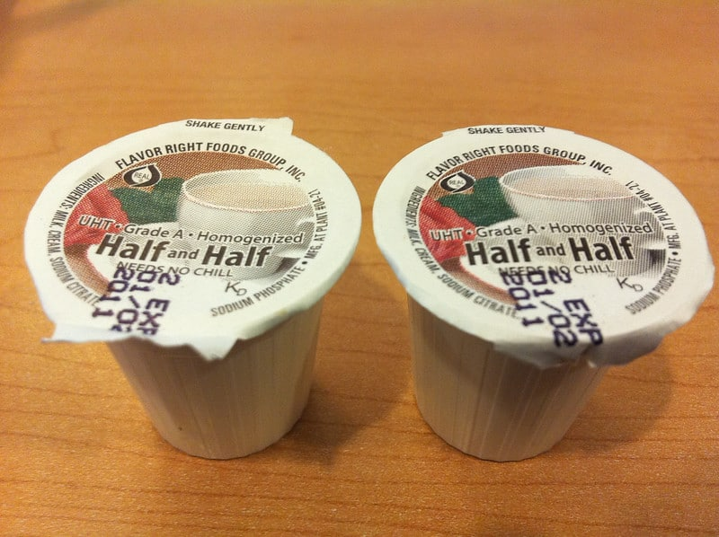 Two tiny cups of half and half